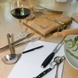 Utensils, notebook and glass of wine — Stock Photo #14209629