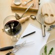 Utensils, notebook and glass of wine — Stock Photo
