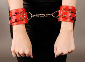 Female hands in handcuffs. — Stock Photo