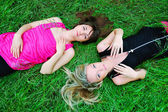 Girls laying in grass — Foto de Stock
