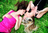 Girls laying in grass — Stock Photo