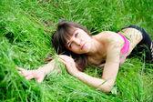 Female lying on grass — Stock Photo