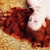 Woman on the dried up ground — Stock Photo