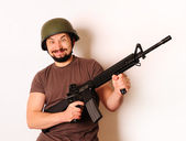 Mad armed man — Stock Photo
