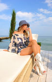Woman in hat on sea beach. — Stock Photo