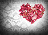 Heart made of petals of roses — Foto Stock