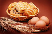 Bakery with wheat ears and eggs — Stock Photo