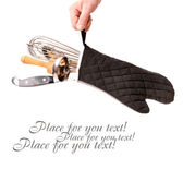 Kitchen accessories in cooking glove — Stock Photo