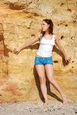 Girl near a rock — Stock Photo