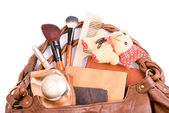 Handbag with cosmetics and toy a bear — Stock Photo