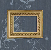 Antique frame on a blue background — Stock Photo