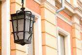 Lantern hanging on the house — Stock Photo