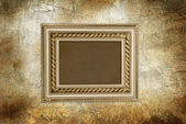 Wall with gold frame — Stock Photo
