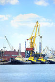 Port with cranes and ships — Stock Photo