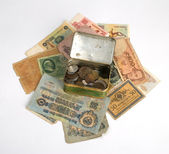 Old currency and metal box with old coins — Stock Photo