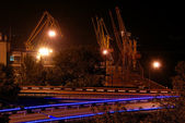 Seaport with cranes and road at night — Stock Photo