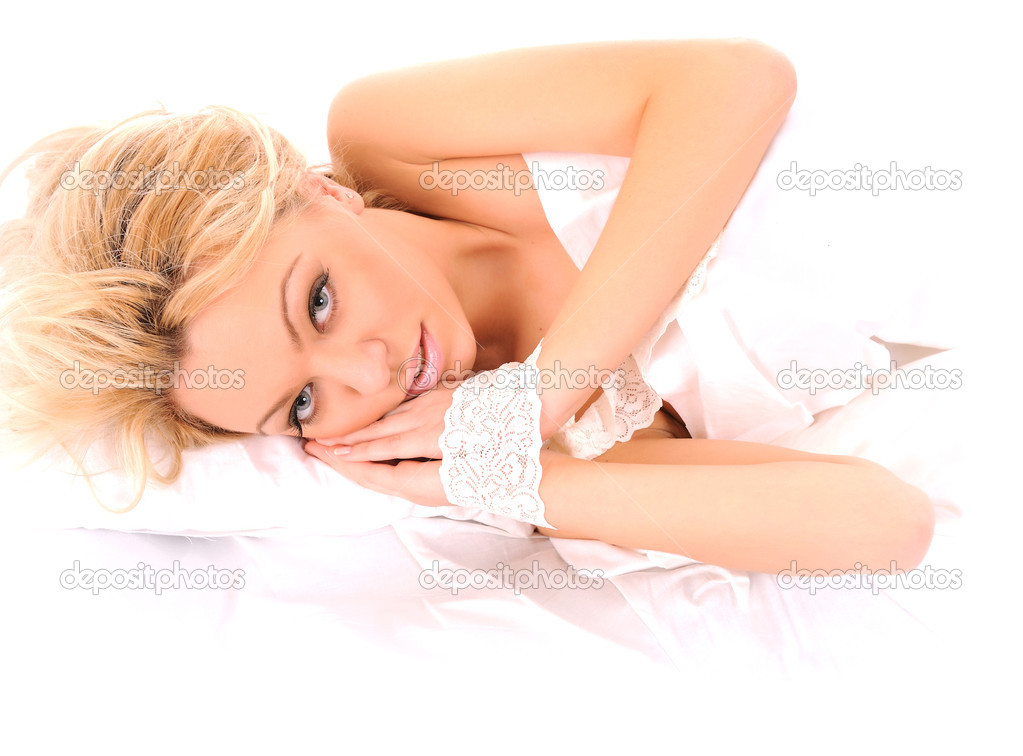 Picture of laying in bed lovely woman over white  Stock Photo #14200887