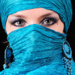 Stock Photo: Blue woman's eyes with east make-up
