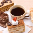Cakes with cup of coffee - Stock Photo