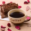 Biscuit cake with cup of coffee - Stock Photo