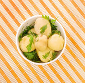 Boiled potatoes with parsley — Stock Photo
