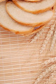 Wheat and bread on a bamboo — Stock Photo