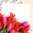Red tulips with music sheet page — Lizenzfreies Foto