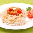 Plate of spaghetti with mushrooms and tomatoes — Stock fotografie