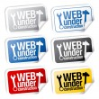 Stock Vector: Web under construction stickers.