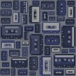 Stock Vector: Cassette tape seamless pattern.