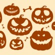 Stock Vector: Halloween pumpkins.