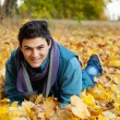 Young man laying in park. — Stock Photo
