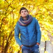 Young man walking in park — Stockfoto