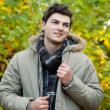Young man walking in park — Stock Photo