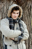 Young man portrait in park. — Stock Photo