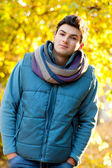Young man portrait in park — Stock Photo