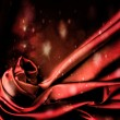 Flashing red satin background. — Stock Photo