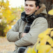 Stock Photo: Young man portrait in park.