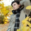 Young man standing in park. — Stock Photo