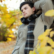Stock Photo: Young man standing in park.