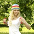 Blonde smiling sporty girl working out outdoor. — Stock Photo