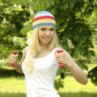 Blonde smiling sporty girl working out outdoor. — Stok fotoğraf