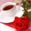 Stock Photo: Rose with cup of tea.