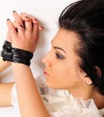 Binding by silk ribbon woman portrait. — Stock Photo