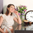 Smiling pregnant woman portrait with a clock. — Stock Photo #37548933