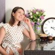 Smiling pregnant woman portrait with a clock. — Stock Photo