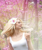 Woman with blonde long hair waving in the wind. — Foto Stock