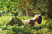 Pregnant woman laying on grass in park. — Stock Photo