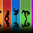 Dancers silhouettes over a rainbow background — Stock Photo #13890382