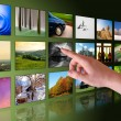 Hand browse photos in virtual reality - Stock Photo